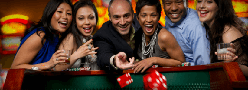 excited-friends-gambling-at-craps-table-in-casino1-820x300